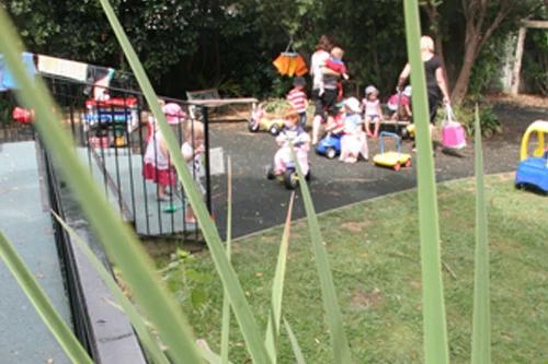 Kids playing folkestone st child care